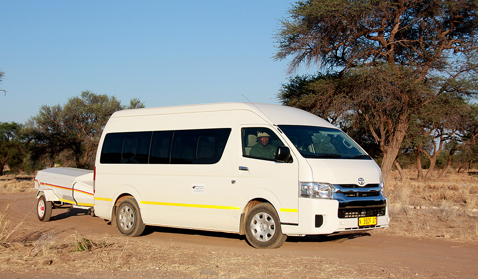 Comfortable bus for Ondekaremba's visitors who make use of the transfer services